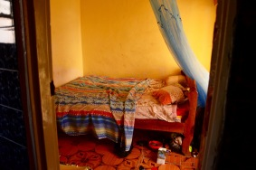 This is what $4/night buys you - small room and no no toilet seat or electricity but there was running water!