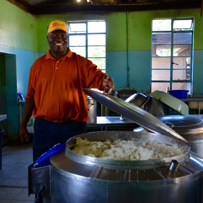 Touring the kitchen - Humfrey shows us the vat of maize meal that feeds the 1000 students and staff