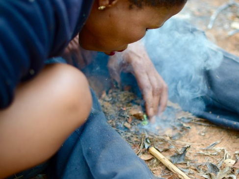 Making a fire to cook the groundnut